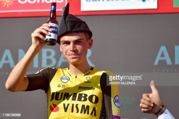 Team Jumbo rider US Sepp Kuss drinks beer as he celebrates on the podium after winning the 15th stage of the 2019 La Vuelta cycling Tour of Spain, a...
