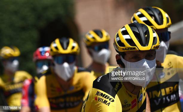 Team Jumbo- Visma riders wearing protective face masks arrive prior the start of the one-day classic cycling race Strade Bianche on August 1, 2020 in...