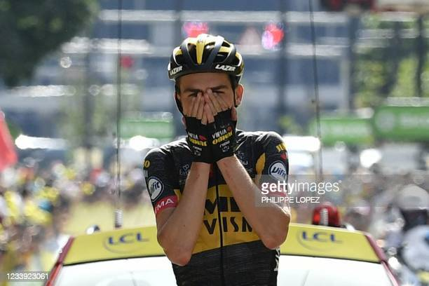 Team Jumbo Visma's Sepp Kuss of US celebrates as he crosses the finish line of the 15th stage of the 108th edition of the Tour de France cycling...