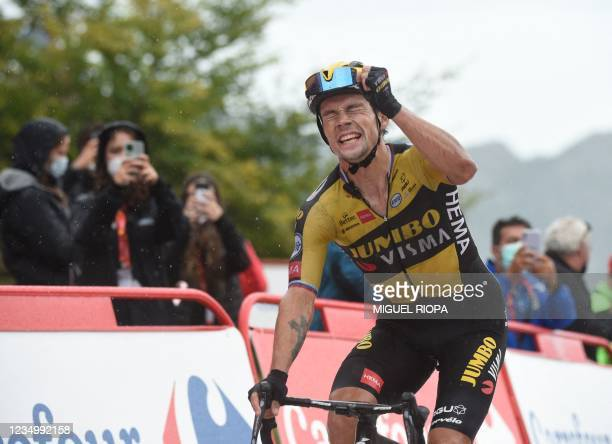 Team Jumbo's Slovenian rider Primoz Roglic celebrates as he wins the 17th stage of the 2021 La Vuelta cycling tour of Spain, a 185.8 km race from...