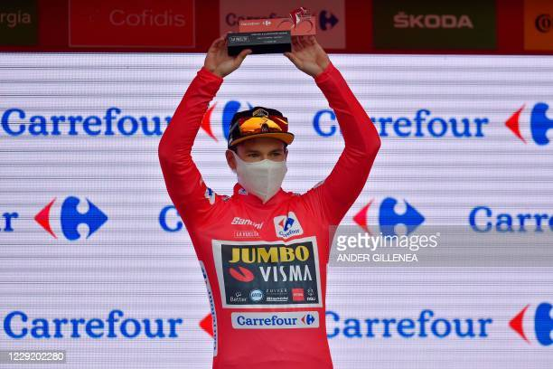 Team Jumbo's Slovenian rider Primoz Roglic celebrates on the podium as he wears the red jersey as the overall race leader after the 2nd stage of the...