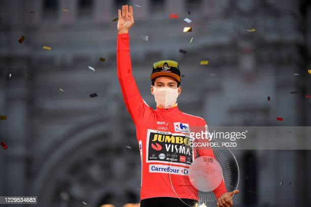Team Jumbo's Slovenian rider Primoz Roglic celebrates on the podium after winning the 2020 La Vuelta cycling tour of Spain at the end of the 18th and...