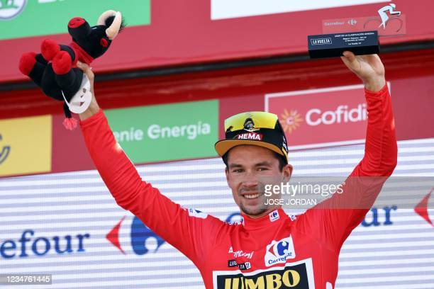 Team Jumbo's Slovenian rider Primoz Roglic celebrates on the podium wearing the overall leader's red jersey after the 6th stage of the 2021 La Vuelta...