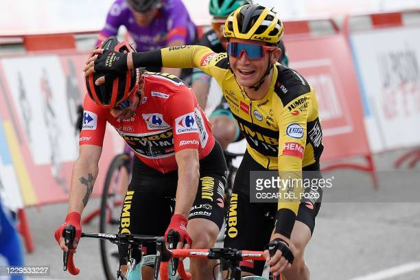 Team Jumbo's Slovenian rider Primoz Roglic is congratluated for winning the 2020 La Vuelta at the end of the 18th and final stage of the 2020 La...