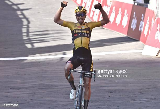 Team JumboVisma Belgian rider Wout van Aert celebrates as he crosses the finish line to win the one-day classic cycling race Strade Bianche on August...