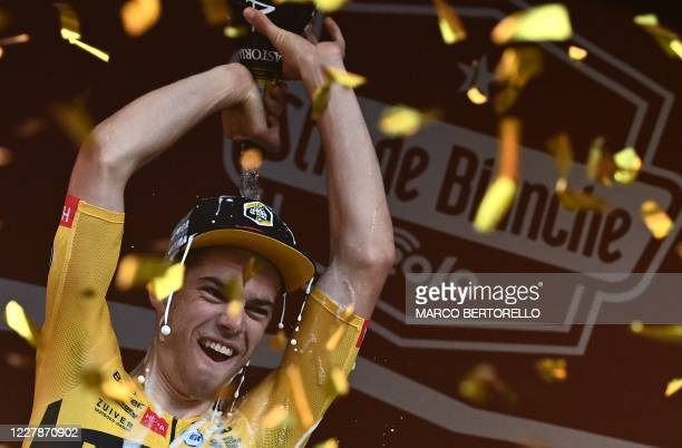 Team JumboVisma Belgian rider Wout van Aert celebrates on podium after the one-day classic cycling race Strade Bianche on August 1, 2020 in Siena,...