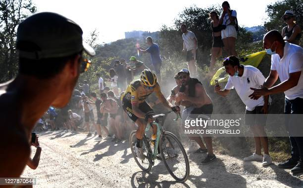 Team JumboVisma Belgian rider Wout van Aert ride during a break away through a dusty gravel road in the one-day classic cycling race Strade Bianche...