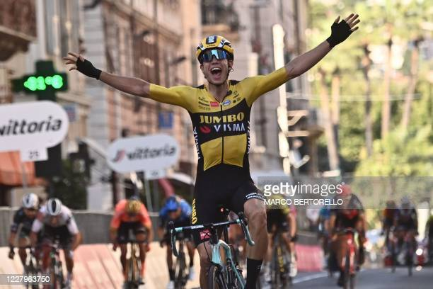 Team Jumbo-Vismarider Belgium's Wout van Aert celebrates after winning the one-day classic cycling race Milan-San Remo in San Remo on August 8, 2020.