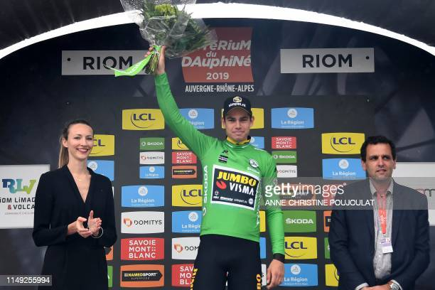 Team JumboVismarider Belgium's Wout van Aert celebrates his best sprinter's green jersey on the podium at the end of the third stage of the 71st...