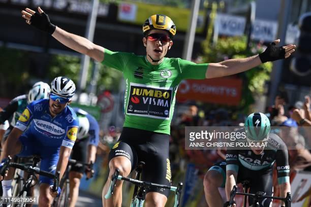 Team Jumbo-Vismarider Belgium's Wout van Aert celebrates, past Bora-Hansgrohe rider Ireland's Sam Bennett and Team Deceuninck-Quick-Step rider...