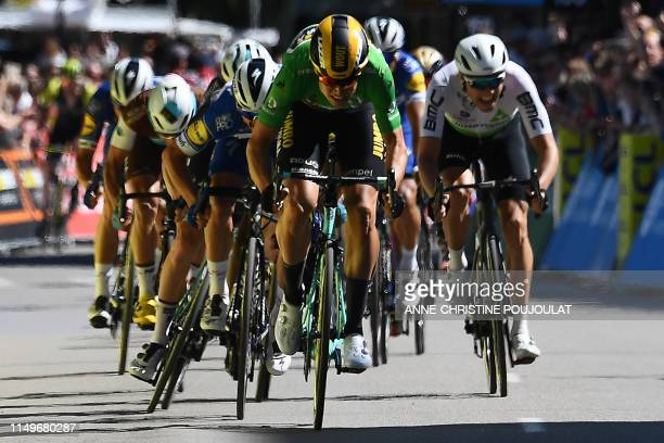 TOPSHOT Team JumboVismarider Belgium's Wout van Aert sprints to win the fifth stage of the 71st edition of the Criterium du Dauphine cycling race 201...