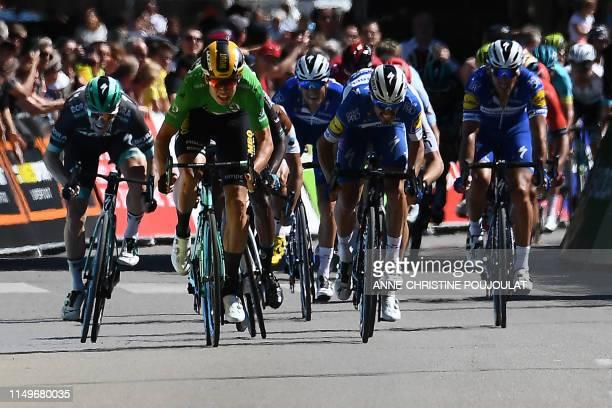 TOPSHOT Team JumboVismarider Belgium's Wout van Aert sprints with BoraHansgrohe rider Ireland's Sam Bennett and Team DeceuninckQuickStep rider...