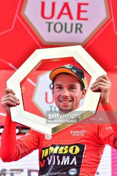 Team JumboVisma's Slovenian rider Primoz Roglic celebrates on the podium his overall victory of the UAE tour in Dubai on March 2 2019