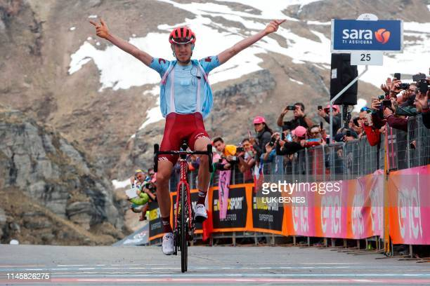 TOPSHOT Team Katusha rider Russia's Ilnur Zakarin reacts as he crosses the finish line to win stage thirteen of the 102nd Giro d'Italia Tour of Italy...
