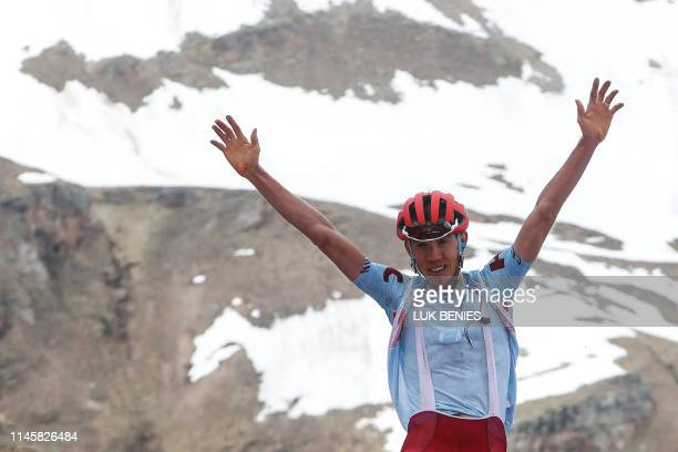 Team Katusha rider Russia's Ilnur Zakarin reacts as he crosses the finish line to win stage thirteen of the 102nd Giro d'Italia - Tour of Italy -...