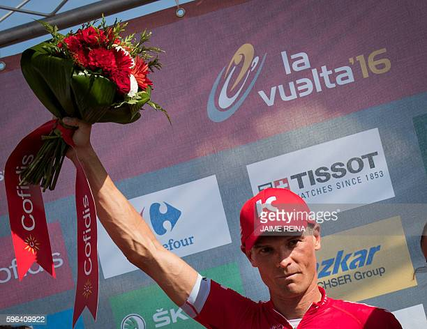 Team Katusha's Russian cyclist Sergey Lagutin celebrates on the podium after winning the 8th stage of the 71st edition of 'La Vuelta' Tour of Spain a...