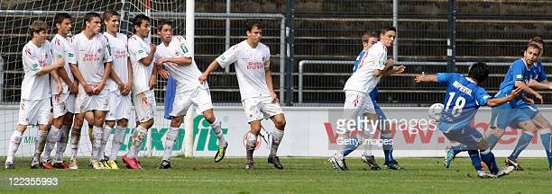 Team Koeln set up a wall against a free kick by Ken Asaeda of Wuppertal during the Regionalliga West match between 1 FC Koeln v Wuppertaler SV at the...