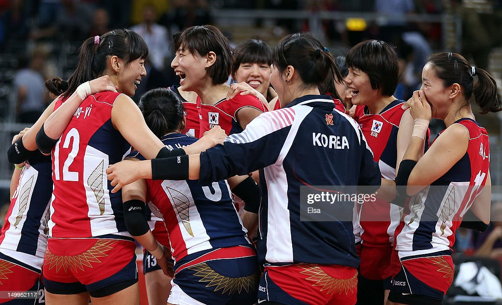 Team Korea celebrates the win over Italy during Women's Volleyball quarterfinals on Day 11 of the London 2012 Olympic Games at Earls Court on August 7, 2012 in London, England.