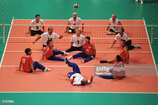 Team Korea sets the ball up in Men's Sitting Volleyball Quaterfinals against Team USA during the Sydney 2000 Paralympic Games on October 26 2000 at...
