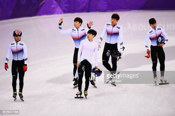Team Korea skate around after an official review places them fourth during the Short Track Speed Skating Men's 5000m Relay Final A on day 13 of the...