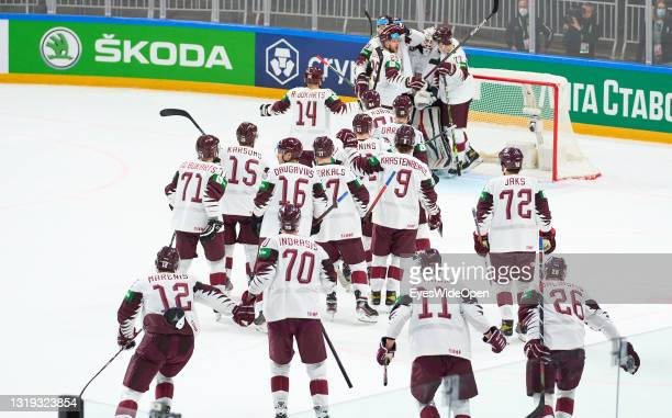Team Latvia celebrate the victory after the 2021 IIHF Ice Hockey World Championship group stage game between Canada and Latvia at Arena Riga on May...