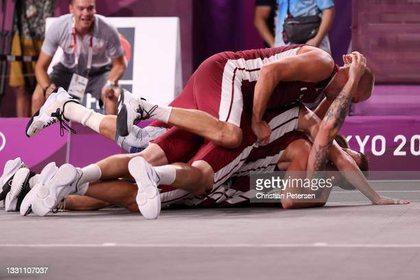 Team Latvia celebrates victory and winning the gold medal in the 3x3 Basketball competition on day five of the Tokyo 2020 Olympic Games at Aomi Urban...