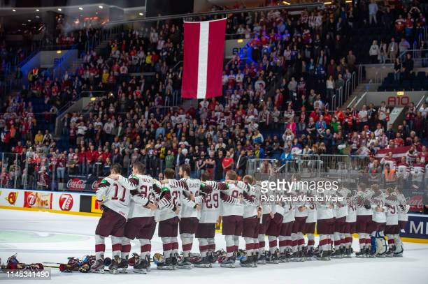 Team Latvia lines up for national anthem during the 2019 IIHF Ice Hockey World Championship Slovakia group game between Norway and Latvia at Ondrej...