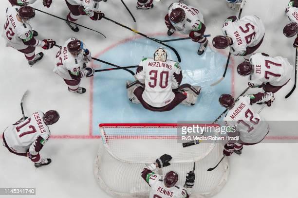 Team Latvia makes a circle around Goalie Elvis Merzlikins of Latvia prior the 2019 IIHF Ice Hockey World Championship Slovakia group game between...