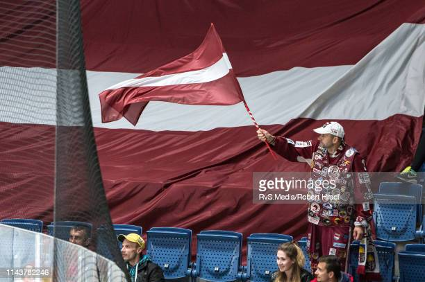 Team Latvia supporter waves a flag during the 2019 IIHF Ice Hockey World Championship Slovakia group game between Italy and Latvia at Ondrej Nepela...