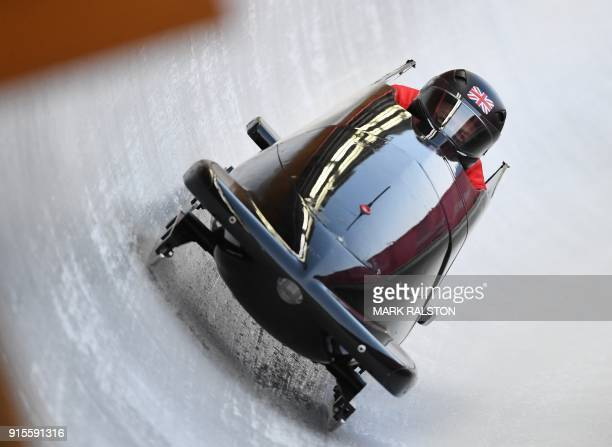Team leader and driver Brad Hall of Britain corners in the second men's unofficial bobsleigh training session at the Olympic Sliding Centre ahead of...