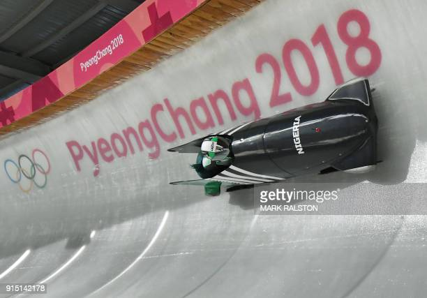 Team leader and driver Seun Adigun of Nigeria take a turn during the first unofficial bobsleigh women training session at the Olympic Sliding Centre...