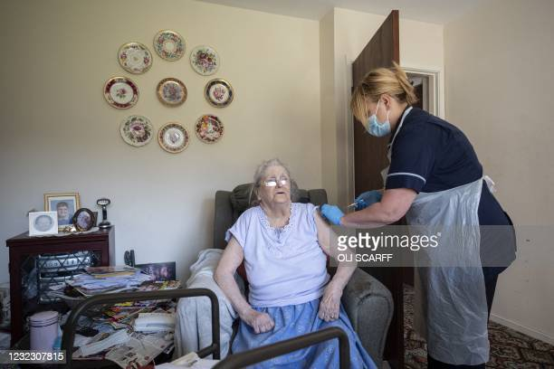 Team leader for housebound vaccinations, Julie Fletcher administers a dose of the AstraZeneca/Oxford Covid-19 vaccine to housebound patient, Hazel...