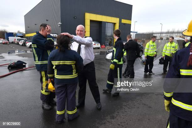 Team leader John Daley congratulates students following a fire and public order demonstration watched by The Prince of Wales during a visit to Dearne...