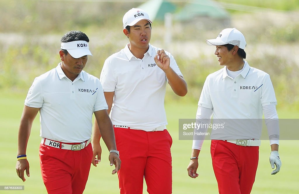 Team leader K.J. Choi (L) walks with Byeong-Hun An (C) and Jeung-hun Wang (R) of Korea during a practice round on Day 4 of the Rio 2016 Olympic Games at Olympic Golf Course on August 9, 2016 in Rio de Janeiro, Brazil.