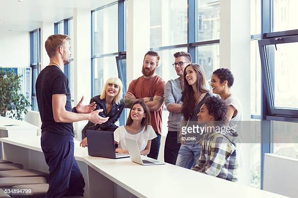 Team leader leading meeting in an office