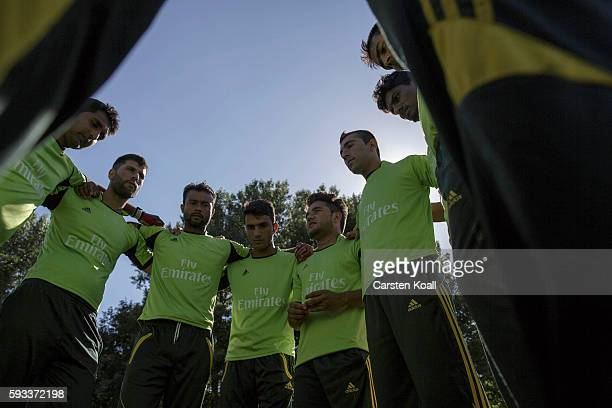 Team leader of the Bautzen cricket team Arshad Ahmad from Pakistan discusses with players before the beginning of the next round in a friendly match...