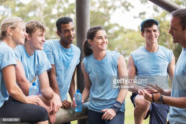 Team leader talking to teammates at boot camp