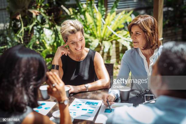 team leaders in start up business are two experienced mature women - responsible business stock photos and pictures
