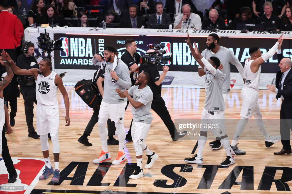 team LeBron exchanges high fives during the NBA All-Star Game as a part of 2018 NBA All-Star Weekend at STAPLES Center on February 18, 2018 in Los Angeles, California.