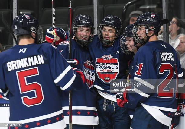 Team Leopold forward Cole Caufield celebrates with Team Leopold defenseman Ben Brinkman Team Leopold defenseman Braden Doyle Team Leopold forward...
