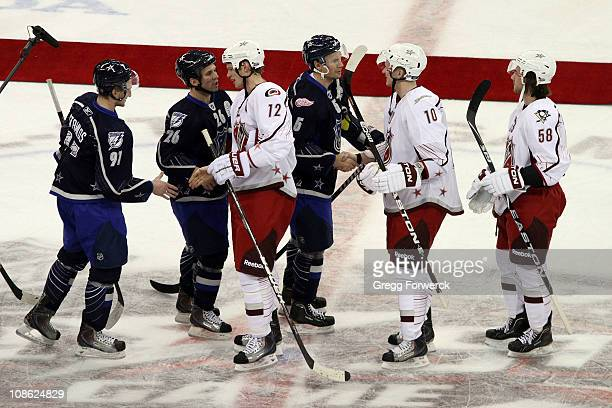 Team Lidstrom and team Staal shake hands after the 58th NHL AllStar Game at the RBC Center on January 30 2011 in Raleigh North Carolina Team Lidstrom...