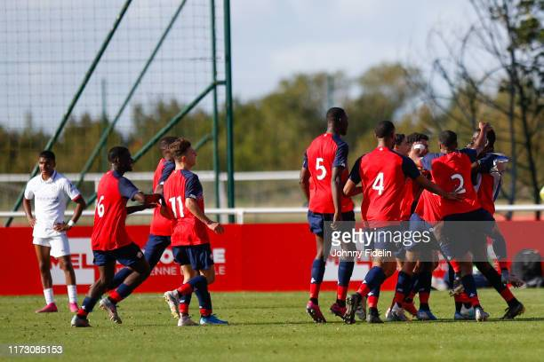 Team Lille celebrate his goal during the Youth League match between Lille and Chelsea at Domaine de Luchin on October 2, 2019 in Lille, France.