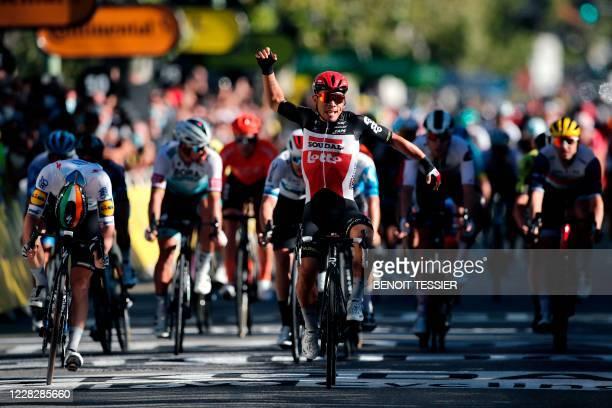 Team Lotto rider Australia's Caleb Ewan celebrates as he crosses the finish line ahead of Team Deceuninck rider Ireland's Sam Bennett during the 3rd...