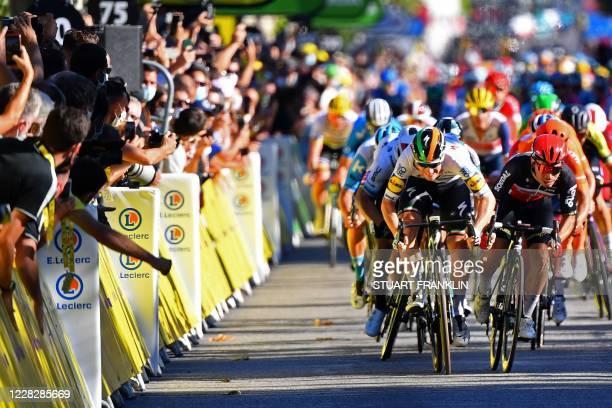 Team Lotto rider Australia's Caleb Ewan sprints next to Team Deceuninck rider Ireland's Sam Bennett before the finish line of the 3rd stage of the...