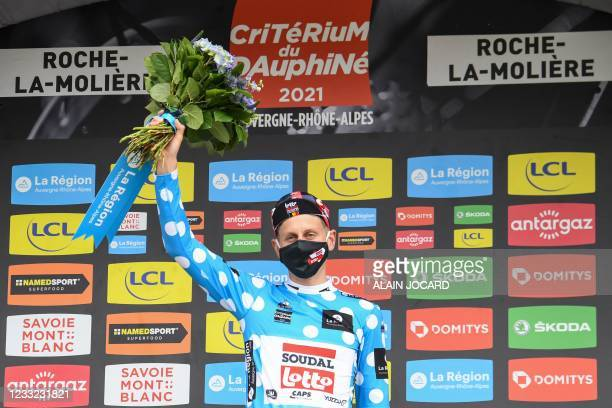 Team Lotto's Matthew Holmes of Great Britain celebrates his best climber's polka dot jersey on the podium after the fourth stage of the 73rd edition...