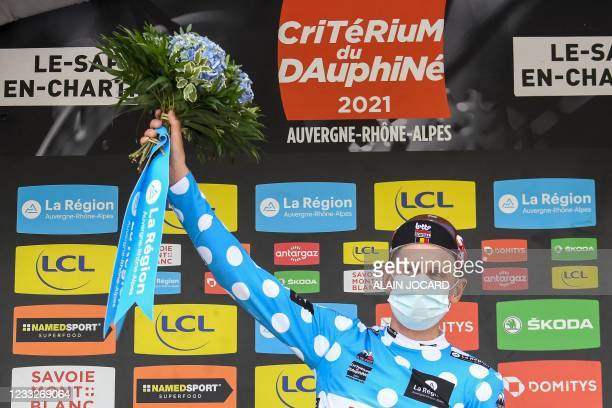 Team Lotto's Matthew Holmes of Great Britain celebrates his best climber's polka dot jersey on the podium at the end of the sixth stage of the 73rd...