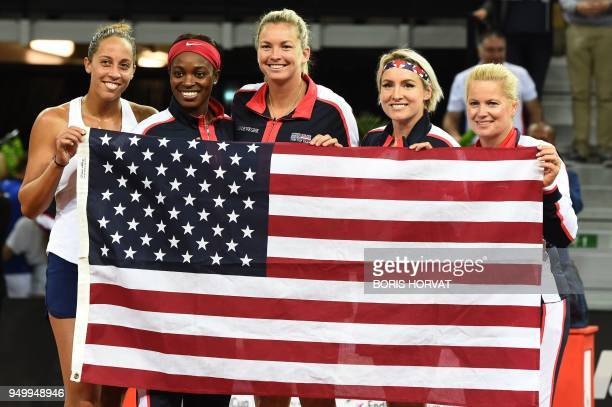 US team Madison Keys Sloane Stephens CoCo Vandeweghe Bethanie MattekSands and Kathy RinaldiStunkel pose with a national flag after their victory at...