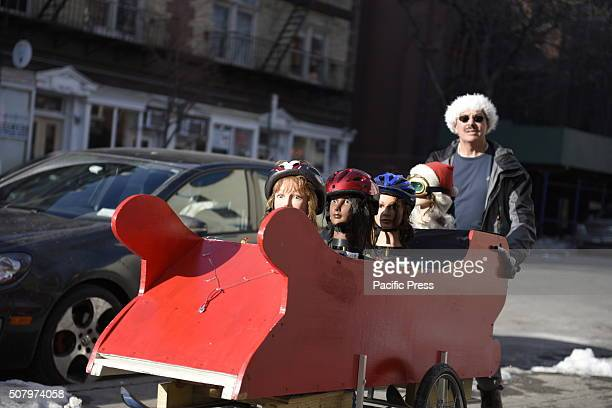 Team makes its way along Court Street in Cobble Hill The 12th annual NYC Idiotarod saw contestants race their elaborately designed carts from...