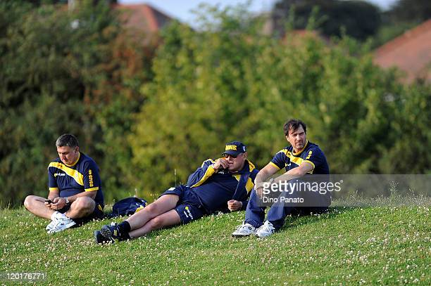 Team manager Alessandro Melli general manager Pietro Leonardi and technical manager Antonello Preiti of Parma look on during a preseason training...