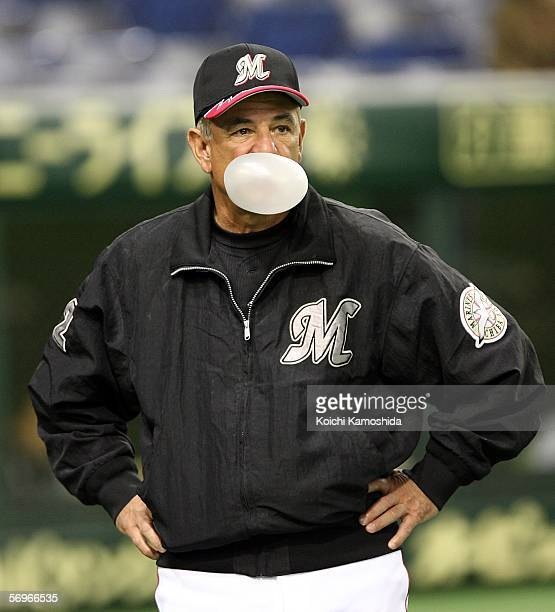 Team Manager Bobby Valentine of the Chiba Lotte Marines blows a bubble during the 2006 World Baseball Classic Exhibition Game against Korea on March...